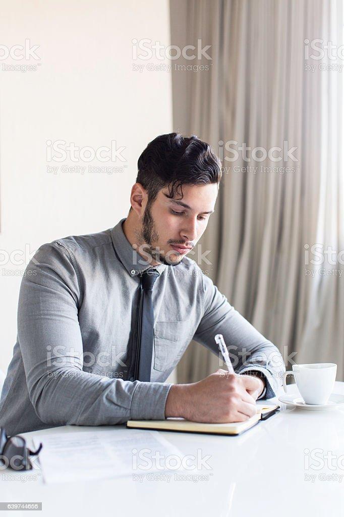 Businessman taking down notes. stock photo