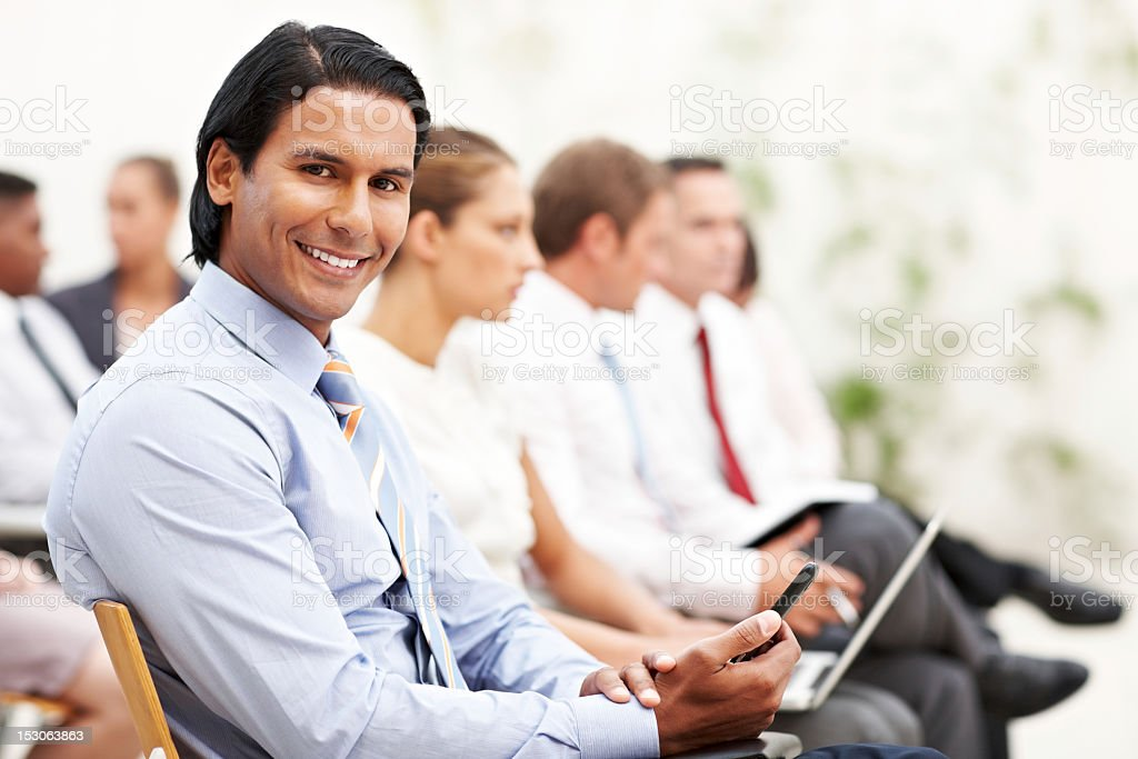 Businessman Taking Notes at a Conference royalty-free stock photo