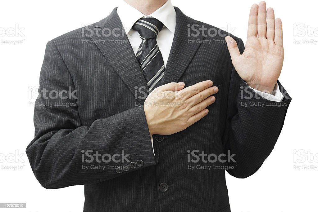 Businessman taking oath stock photo