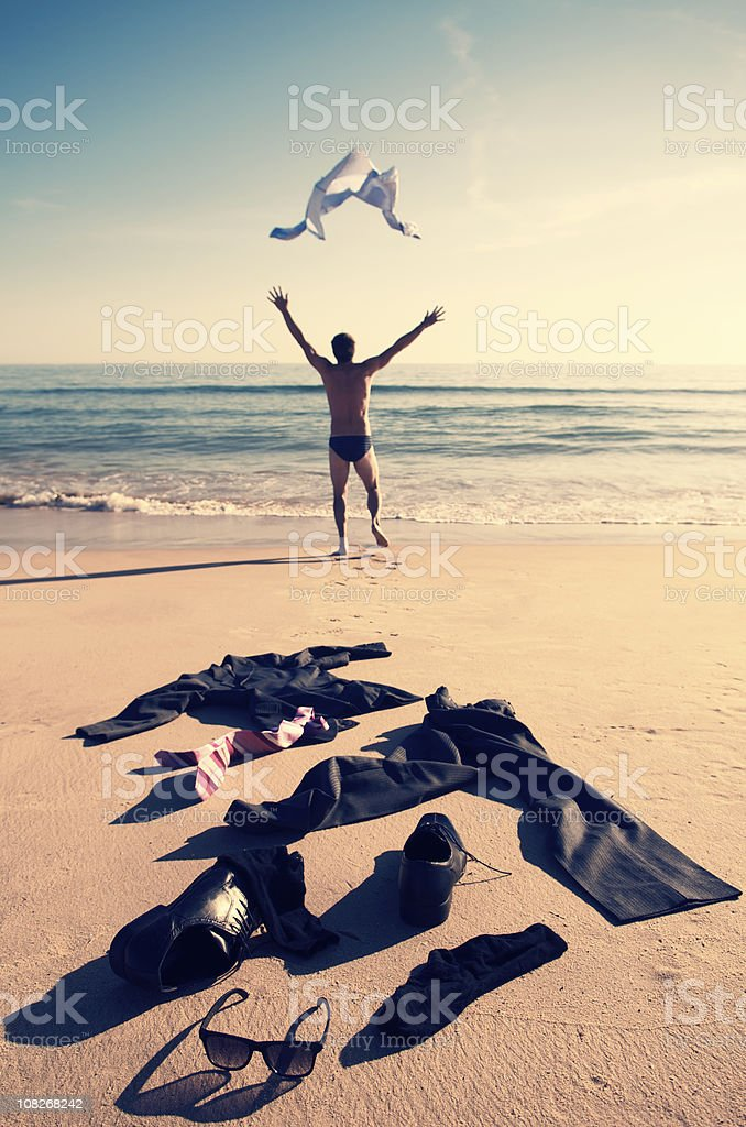 Businessman Taking Off Clothes and Running into Ocean royalty-free stock photo