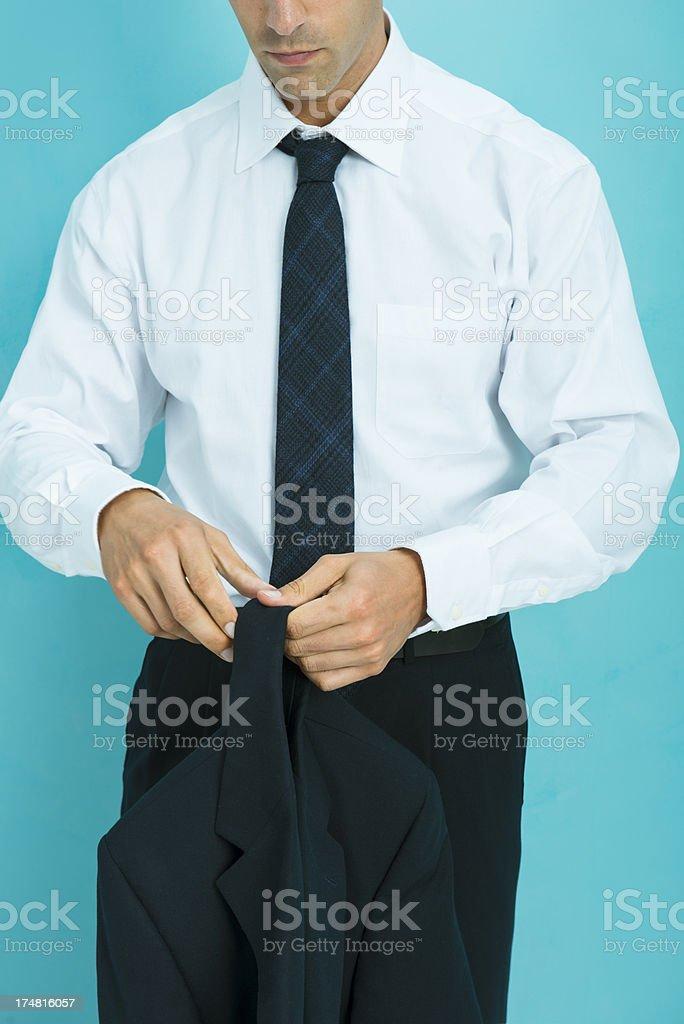 Businessman taking off  jacket royalty-free stock photo