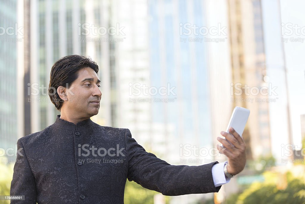 Businessman Taking Self Portrait in Business District royalty-free stock photo