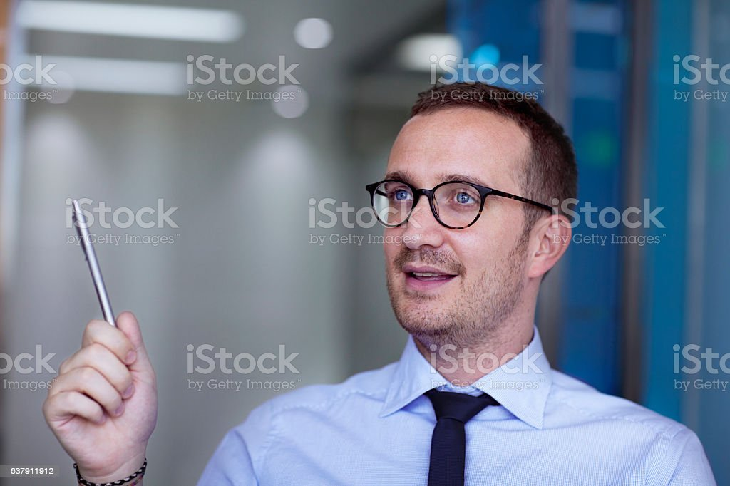 Businessman talking during meeting in office stock photo