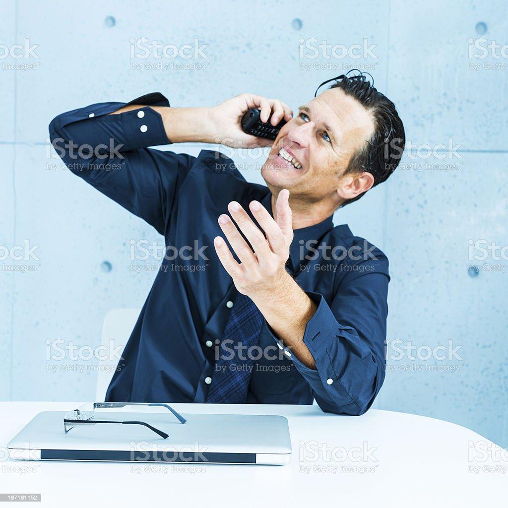 Businessman talking friendly on phone stock photo