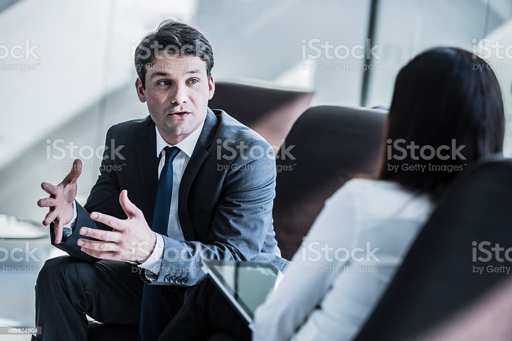 Businessman talking in meeting stock photo