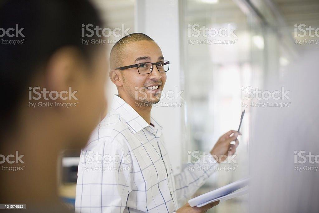Businessman talking in office stock photo