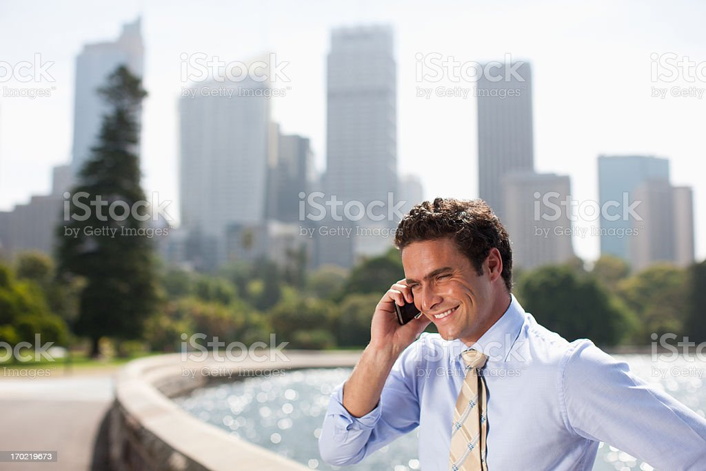 Businessman talking on cell phone at waterfront stock photo