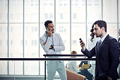 Businessman talking on cell phone in office building
