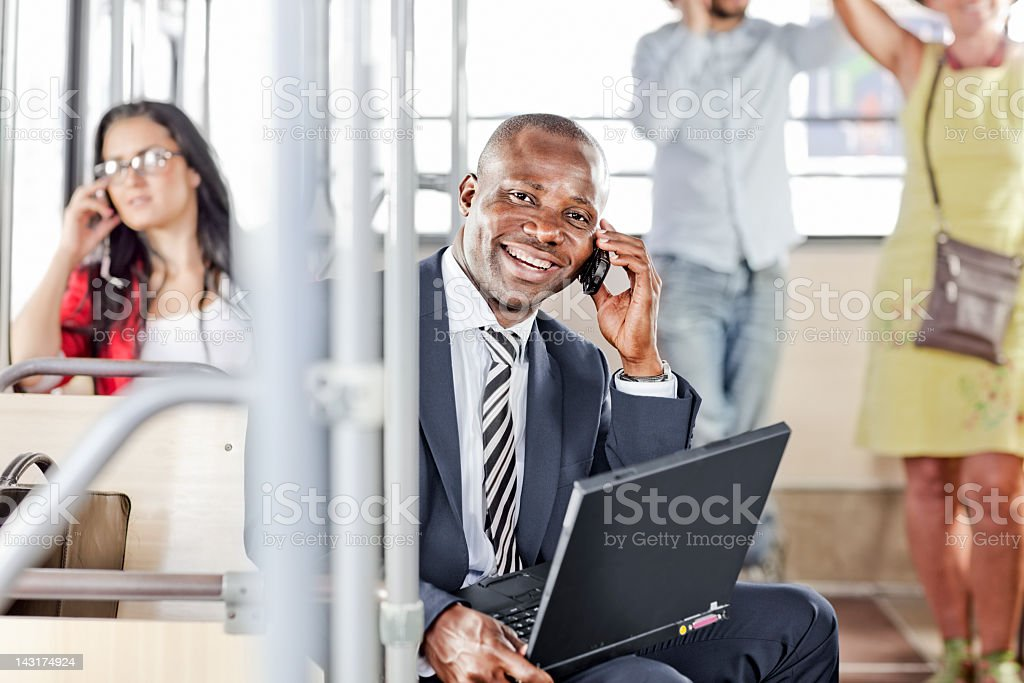 businessman talking on cell phone in  the piblic  bus royalty-free stock photo