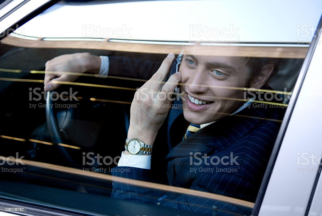Businessman Talking on Cell Phone While Driving royalty-free stock photo