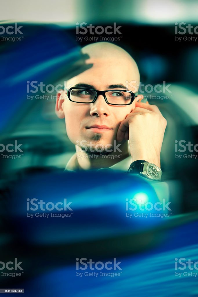 Businessman Talking on Mobile Phone and Driving Convertible royalty-free stock photo