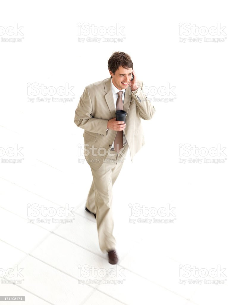 Businessman talking on mobile phone, busy, Walking. royalty-free stock photo