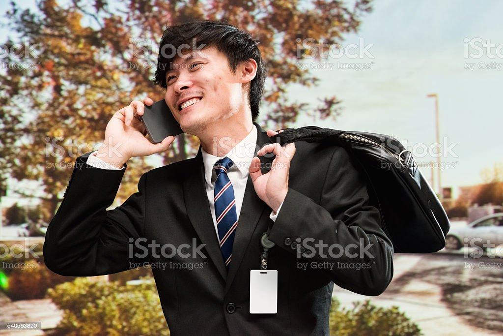 Businessman talking on mobile phone stock photo