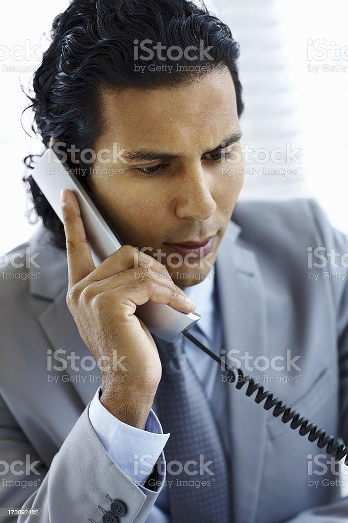 Businessman talking on phone royalty-free stock photo