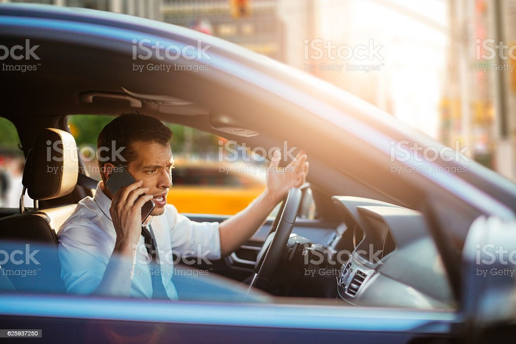 Businessman talking on phone stock photo