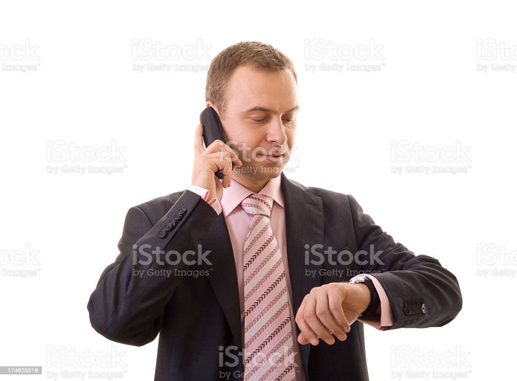 businessman talking on the phone and checking time royalty-free stock photo