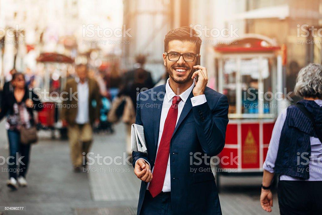 Businessman talking on the phone stock photo