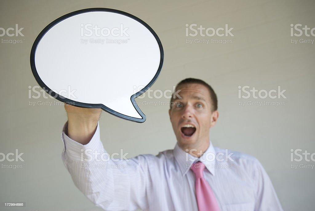 Businessman Talking Under Big Speech Bubble royalty-free stock photo