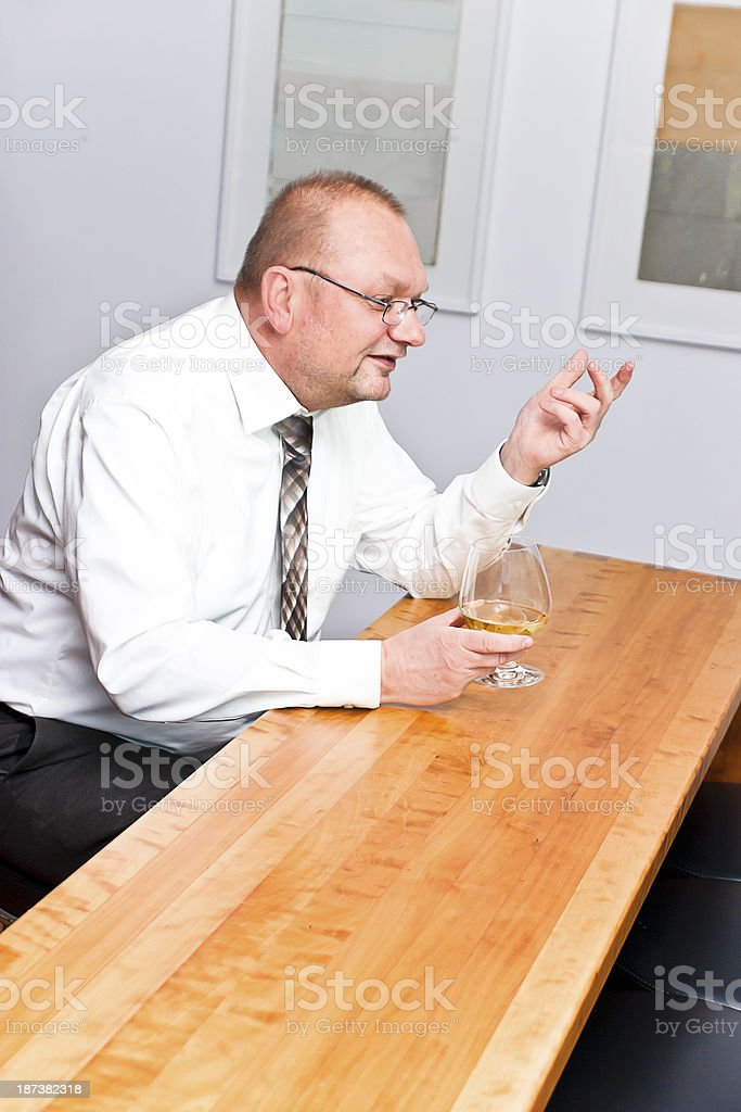 Businessman talking with bartender stock photo