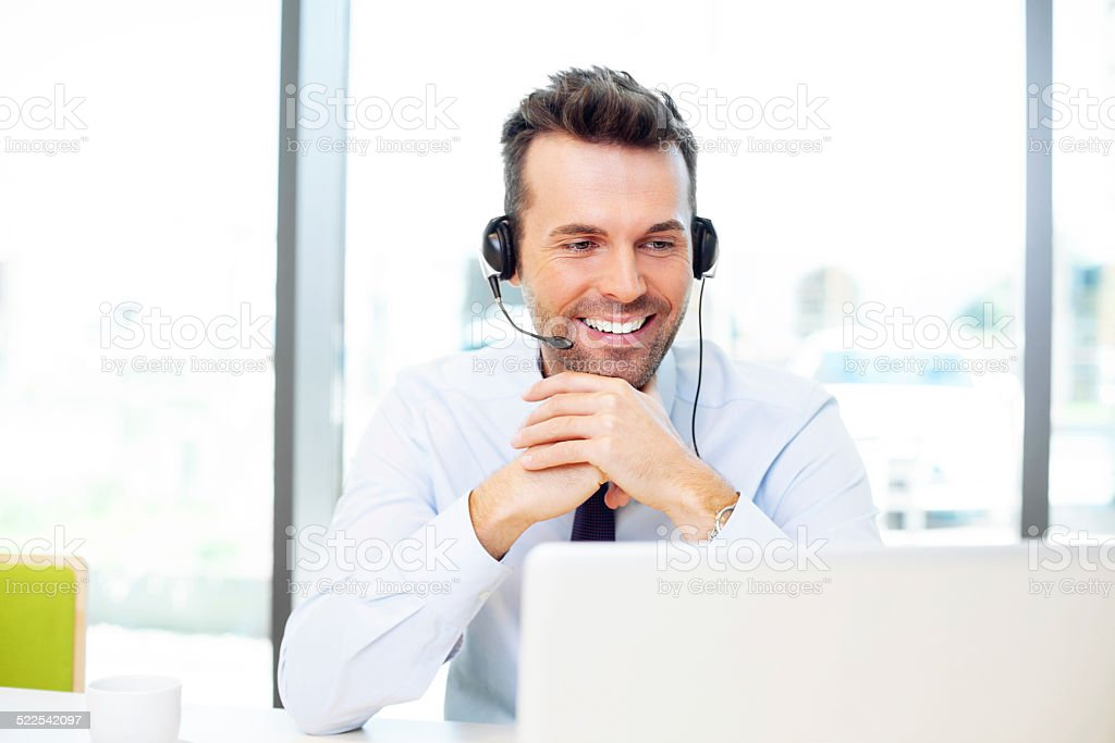 Businessman talking with headset stock photo