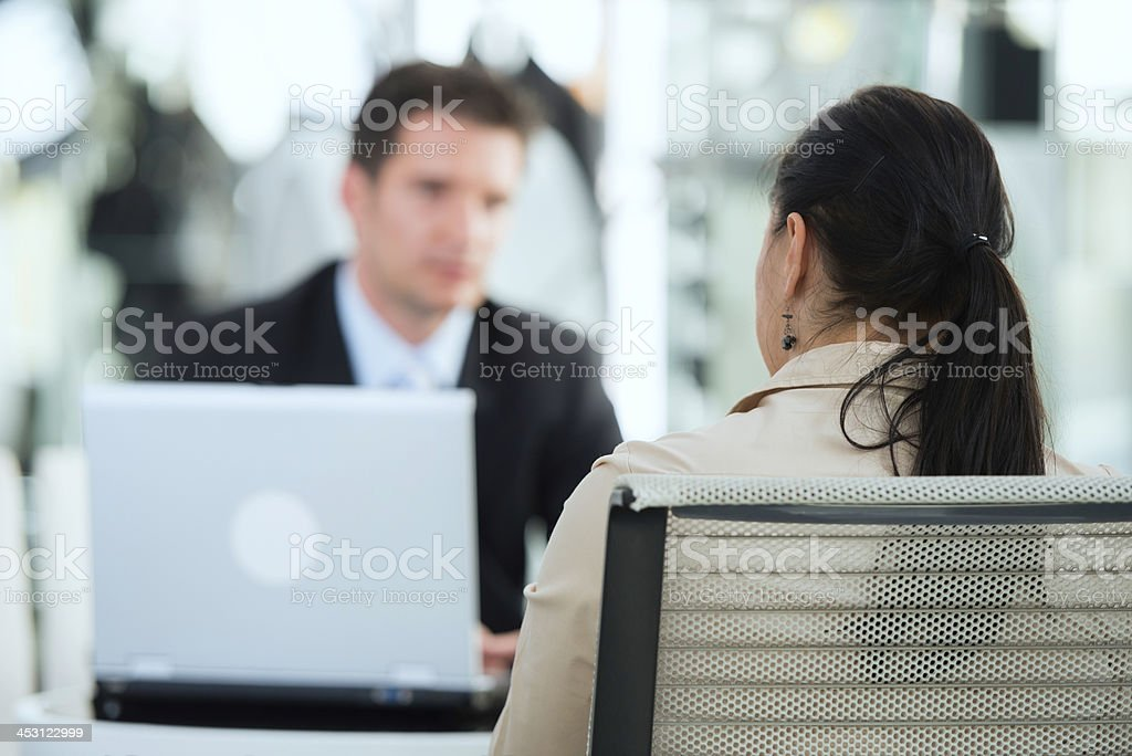 Businessman talking with mid adult woman royalty-free stock photo