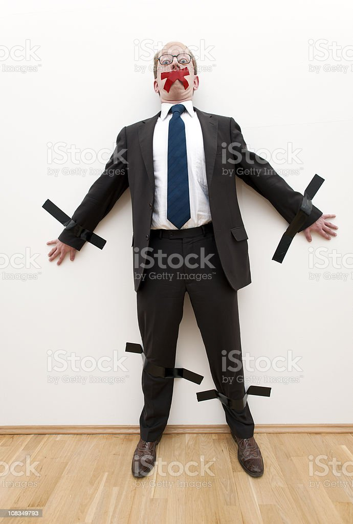businessman taped to wall XXXL image royalty-free stock photo
