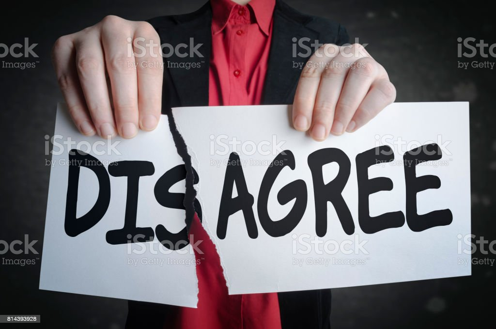 Businessman tearing up a sign saying - Disagree - making the agreement stock photo