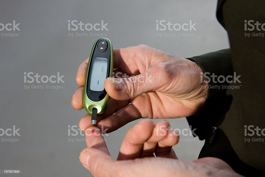 Businessman Tests Blood Glucose royalty-free stock photo
