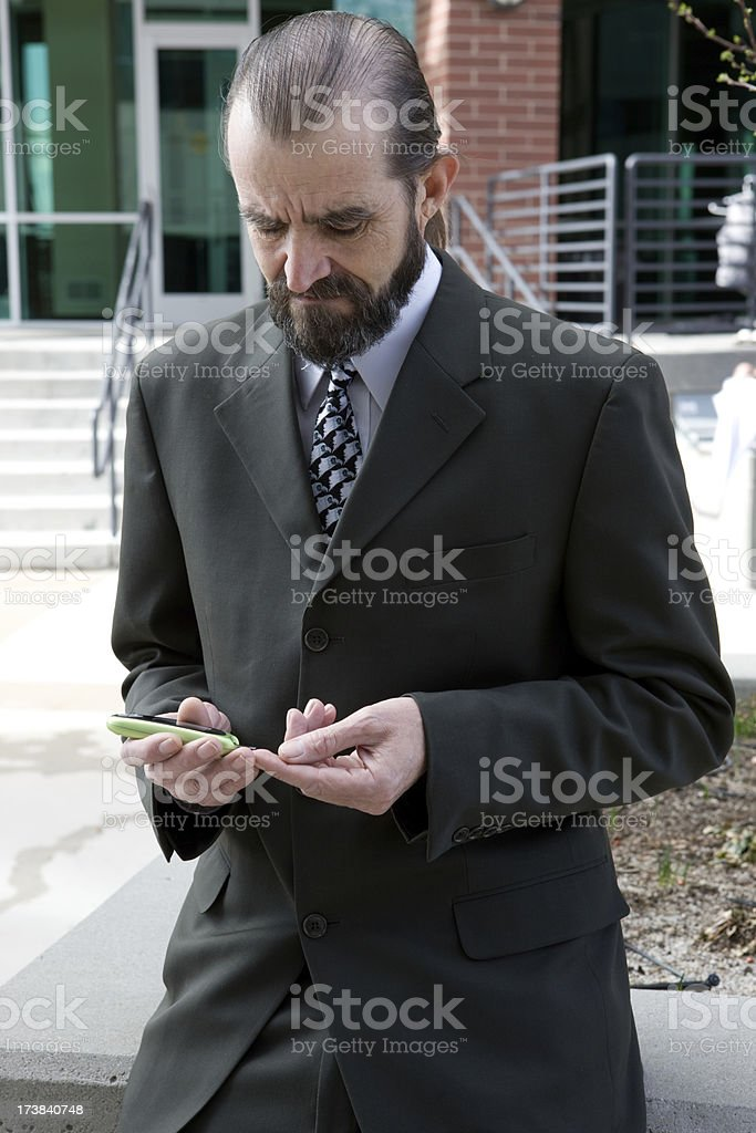 Businessman Tests Blood Sugar Outside His Office royalty-free stock photo