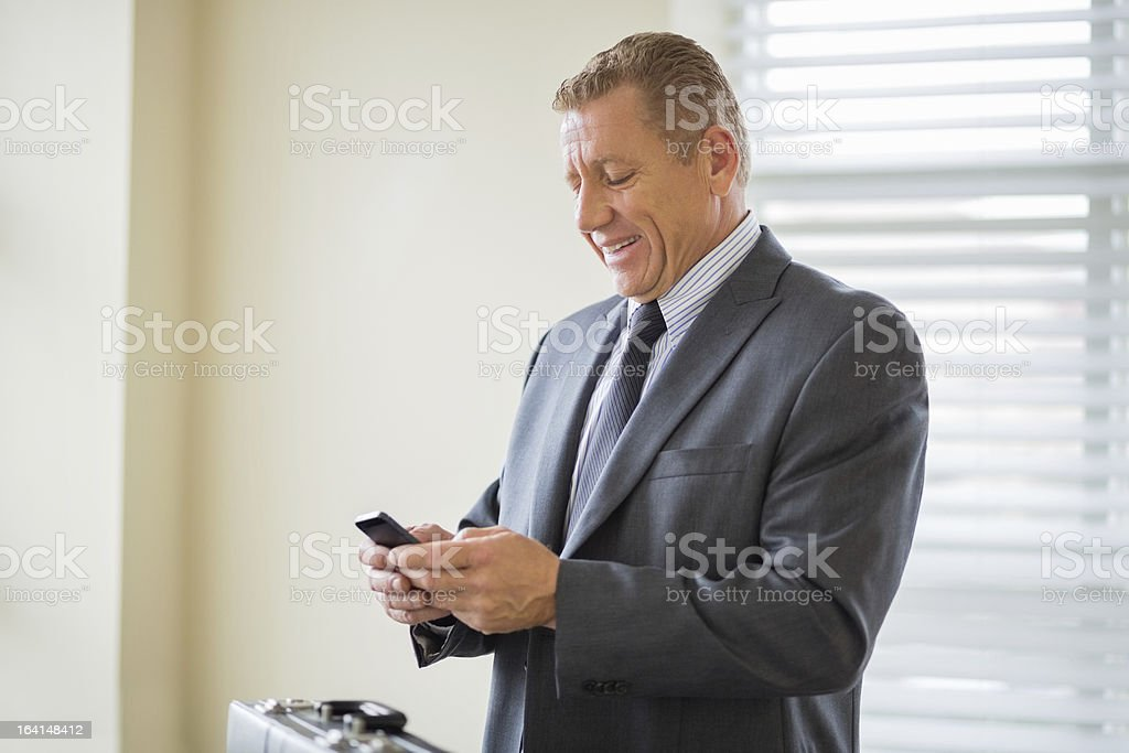 Businessman Text Messaging In Office royalty-free stock photo