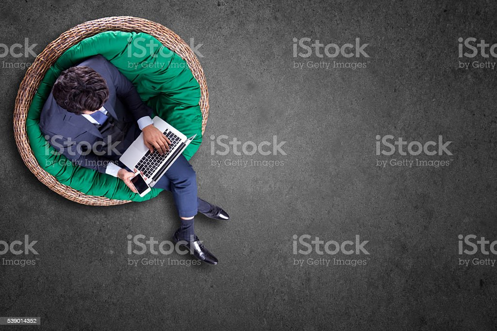Businessman text messaging on mobile phone stock photo