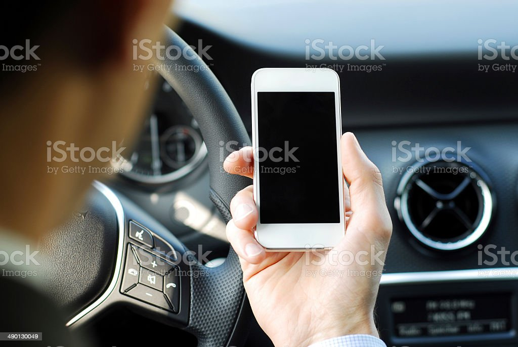 Businessman texting while driving a car royalty-free stock photo