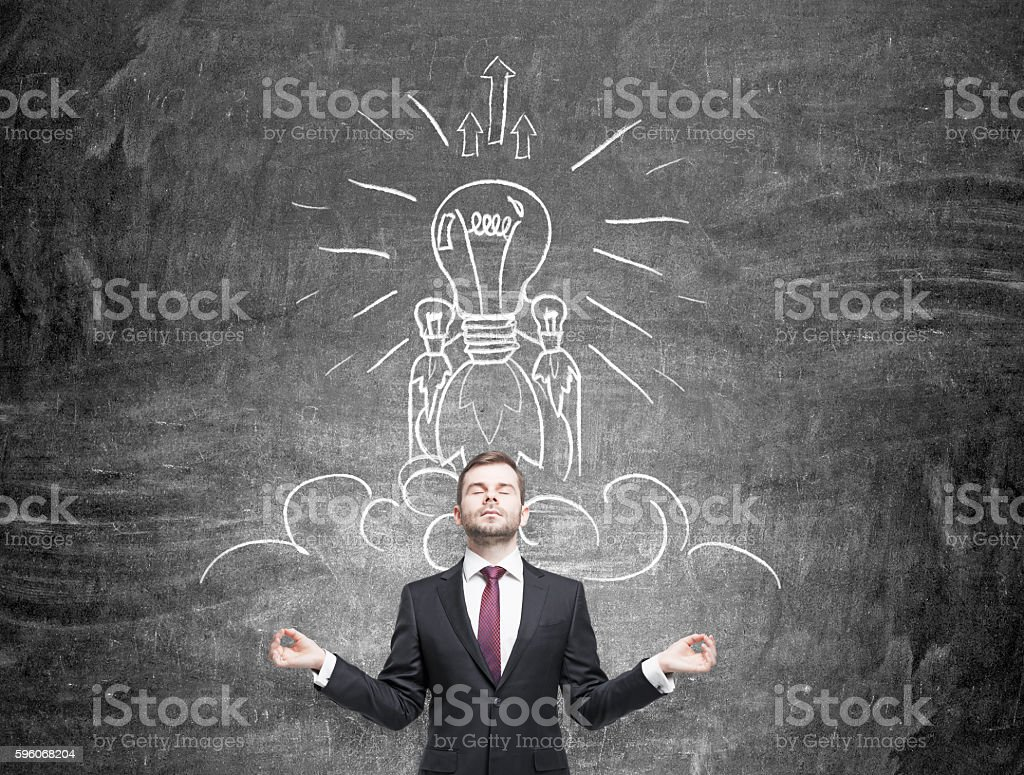 Businessman thinking about achieving goals stock photo