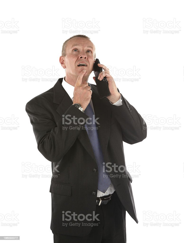 Businessman thinking and using mobile phone royalty-free stock photo