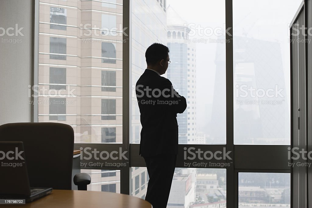 businessman thinking in office stock photo