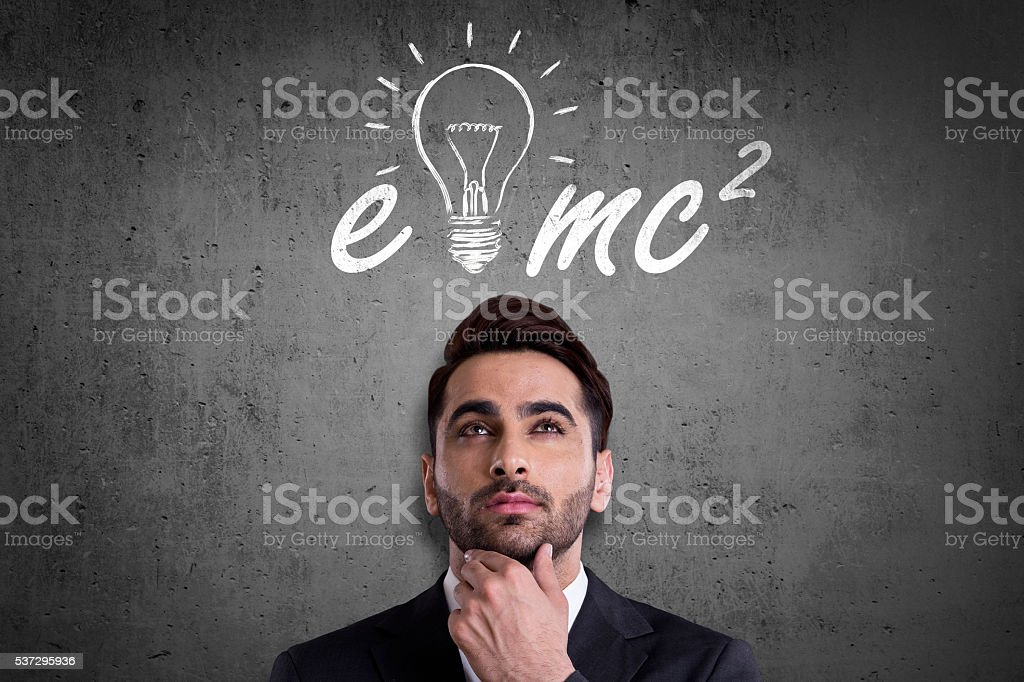 Businessman thinking of Albert Einstein formula stock photo
