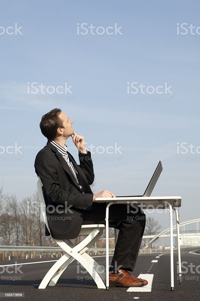 Businessman thinking on road to succes, cloud computing royalty-free stock photo