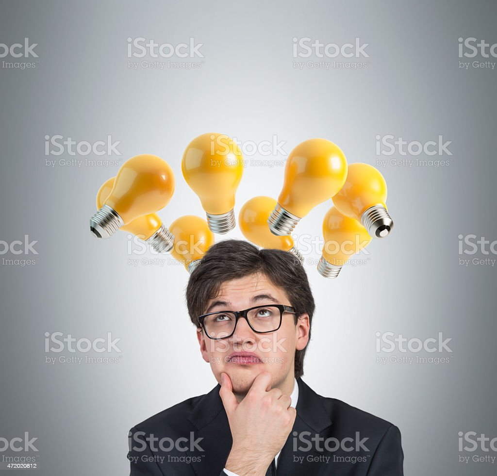 businessman thinking with bulb stock photo