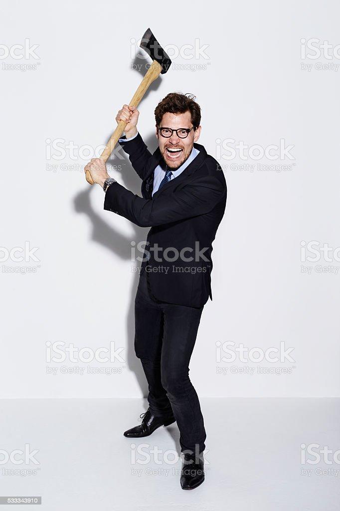 Businessman threatening with axe, portrait stock photo