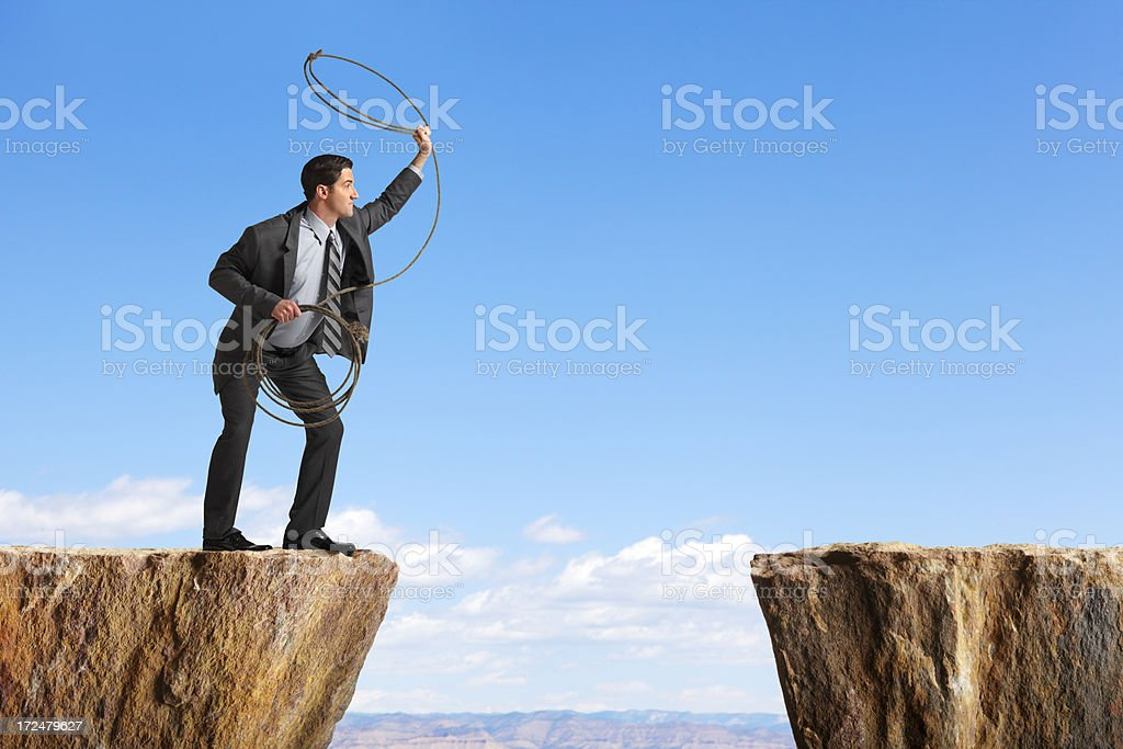 Businessman Throwing a Lasso royalty-free stock photo