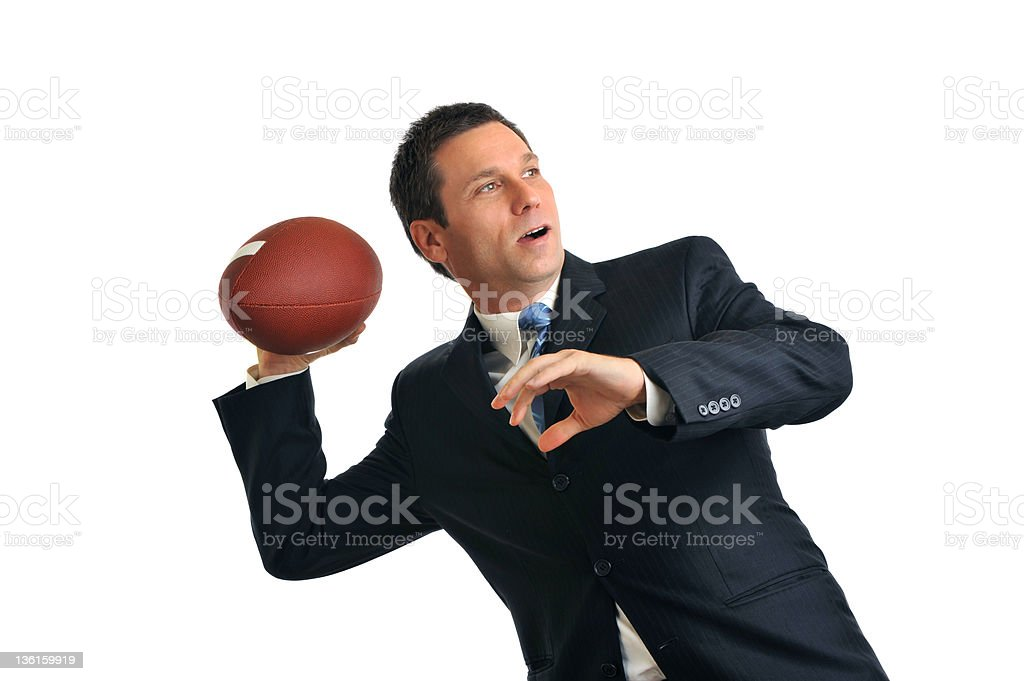 Businessman Throwing American Football Isolated on White Background stock photo