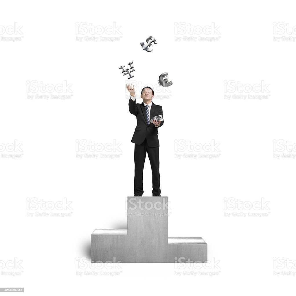 Businessman throwing and catching 3D sliver money symbols on podium royalty-free stock photo