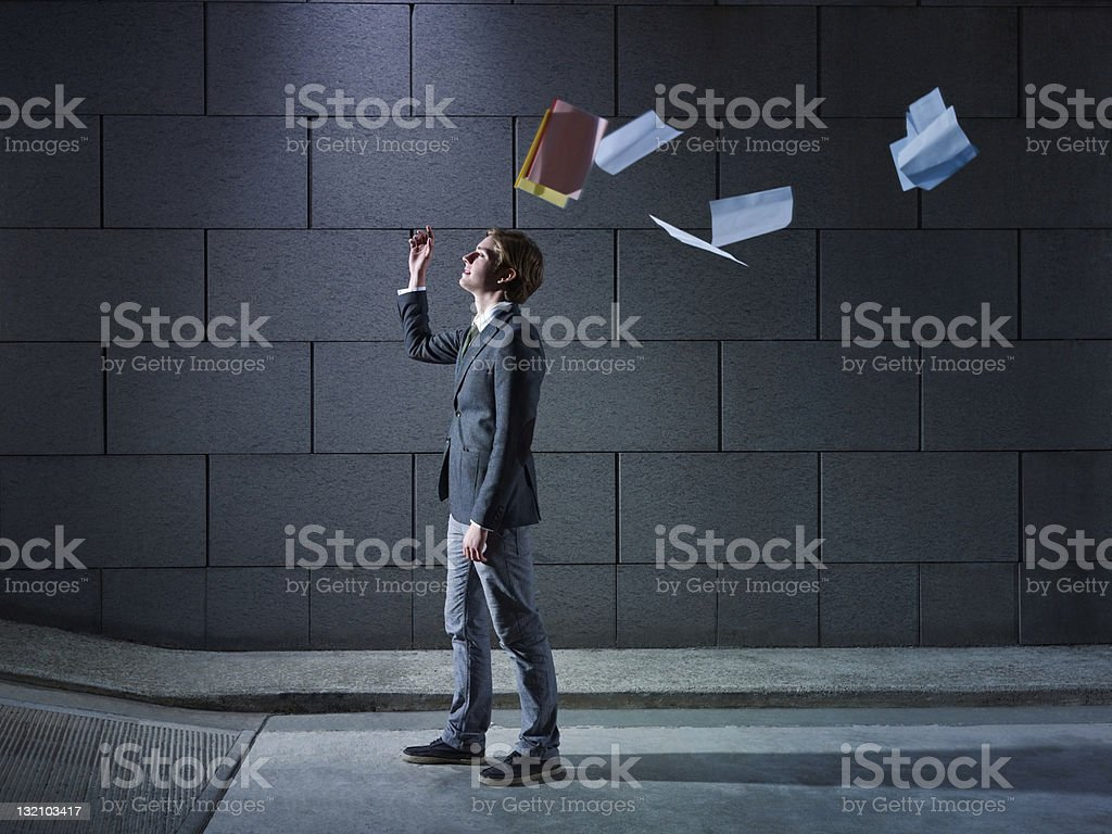 businessman throwing away files and documents stock photo