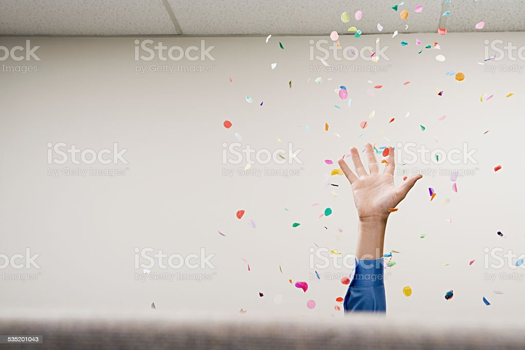 Businessman throwing confetti in the air stock photo
