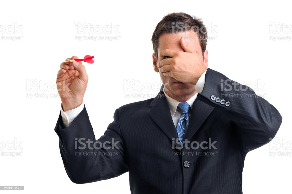 Businessman Throwing Dart on White stock photo
