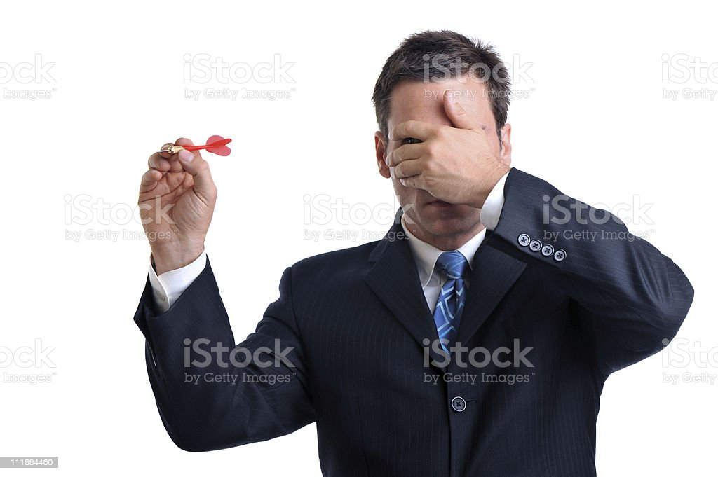Businessman Throwing Dart without Looking on White stock photo
