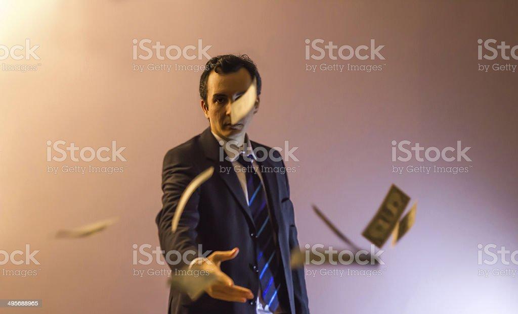 Businessman Throwing Dollars stock photo