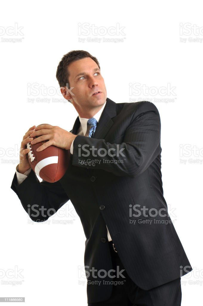 Businessman throwing football Isolated on White Background stock photo