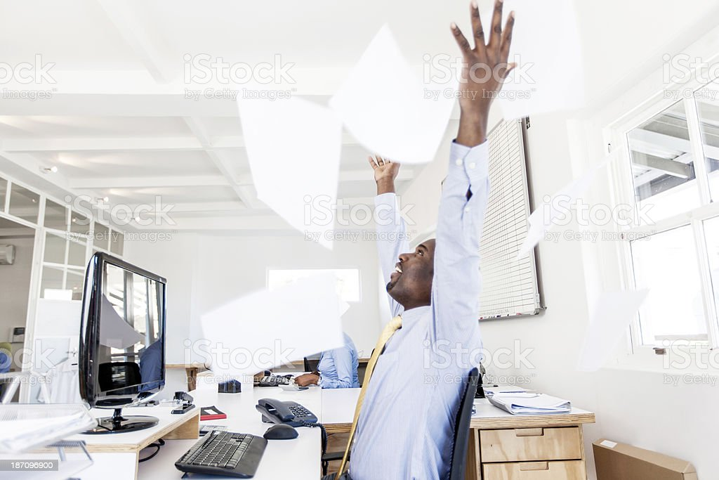 Businessman throwing his paperwork in the air with joy! royalty-free stock photo