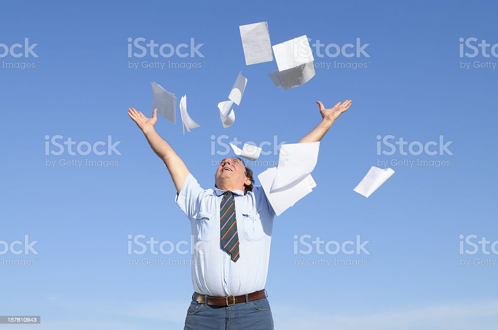 Businessman Throwing Papers Blue Sky stock photo